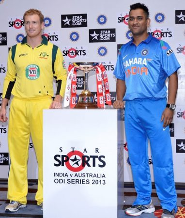 Dhoni and Bailey with the trophy