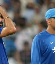 India's captain Mahendra Singh Dhoni (R) and teammate Virat Kohli look on ahead of the start of the third T20 cricket match between India and South Africa at The Eden Gardens Stadium in Kolkata on October 8, 2015. AFP PHOTO / DIBYANGSHU SARKAR ----IMAGE RESTRICTED TO EDITORIAL USE - STRICTLY NO COMMERCIAL USE--        (Photo credit should read DIBYANGSHU SARKAR/AFP/Getty Images)