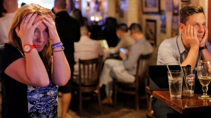 People gathered in The Churchill Tavern, a British themed bar, react as the BBC predicts Britain will leave the European Union, in the Manhattan borough of New York